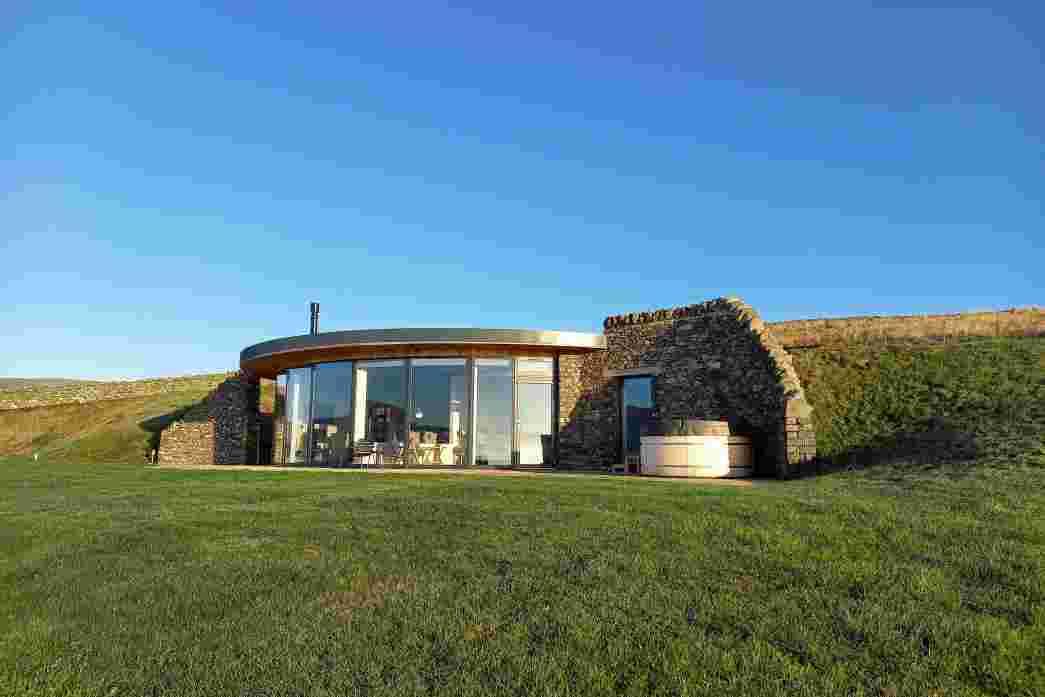 Full height panoramic windows take advantage of the fantastic Borders scenery