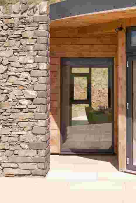 Inspiration and materials came from the landscape, stone for the walls and timber harvested on the farm